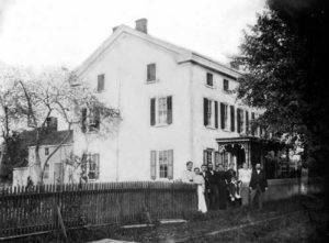 Henry Muhlenberg House, 201 W. Main Street, c. 1890. This photograph shows the west side of the house in which Henry and Mary Muhlenberg lived from 1776 to 1787. About 1863, the roofline was raised four feet to add a third story to the house. The people depicted here are probably members of the Hunsberger family, who owned the property from 1848 to 1895. (Courtesy of the Historical Society of Trappe, Collegeville, Perkiomen Valley.)