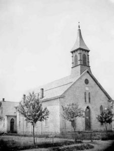St. Luke Reformed Church, c. 1875. Founded in 1742, the St. Luke German Reformed congregation (now United Church of Christ) initially worshipped in a log church located across the street in what is now the cemetery. A stone building replaced it on the same site in 1835. The present church, located at 200 W. Main Street, was erected in 1874 under the leadership of Rev. John H. A. Bomberger, founder of Ursinus College and a Reformed Church minister. This photograph was taken soon after its construction. In 1902 the iron fence was replaced by a stone wall and the building was completely renovated two years later. (Courtesy of the Ursinus College Archives.)